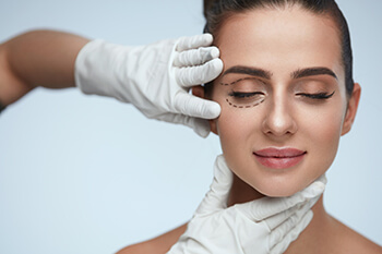 Woman being treated for Blepharoplasty