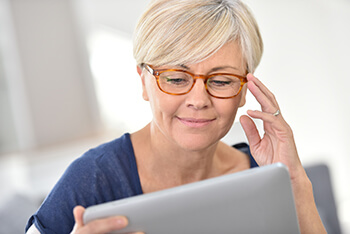 Woman with glasses researching Cataracts