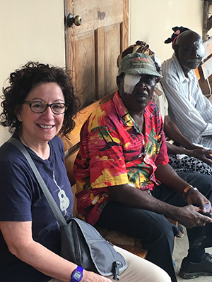 Cynthia, a MEC Ophthalmic Technologist, visiting with patients post-surgery