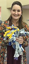 Woman holding dog toys