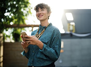 Woman smiling holding a phone