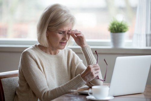 Woman Struggling with Eye Pain due to Bad Prescription