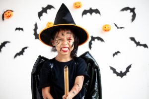 Young girl dressed up as a witch