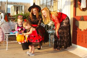 Children and their parents dressed up in Halloween Costumes