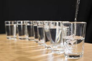 Water being poured into glasses