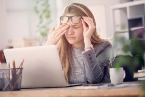 Woman suffering from eye strain