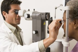 Ophthalmologist checking a patients' eyes
