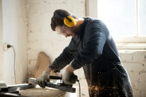 Worker using eye protection while working