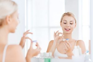 Woman using contact lenses