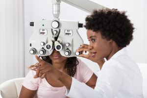 Eye Doctor performing an eye exam on a patient