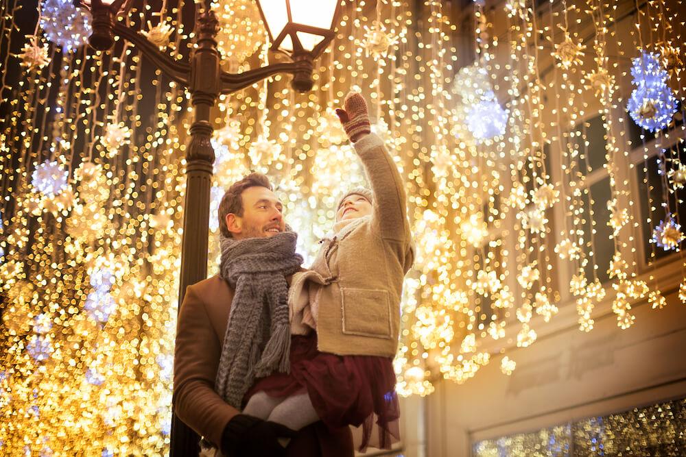 Family looking at holiday lights