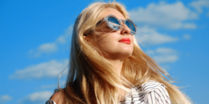 Woman in Sunglasses Looking at the Sky