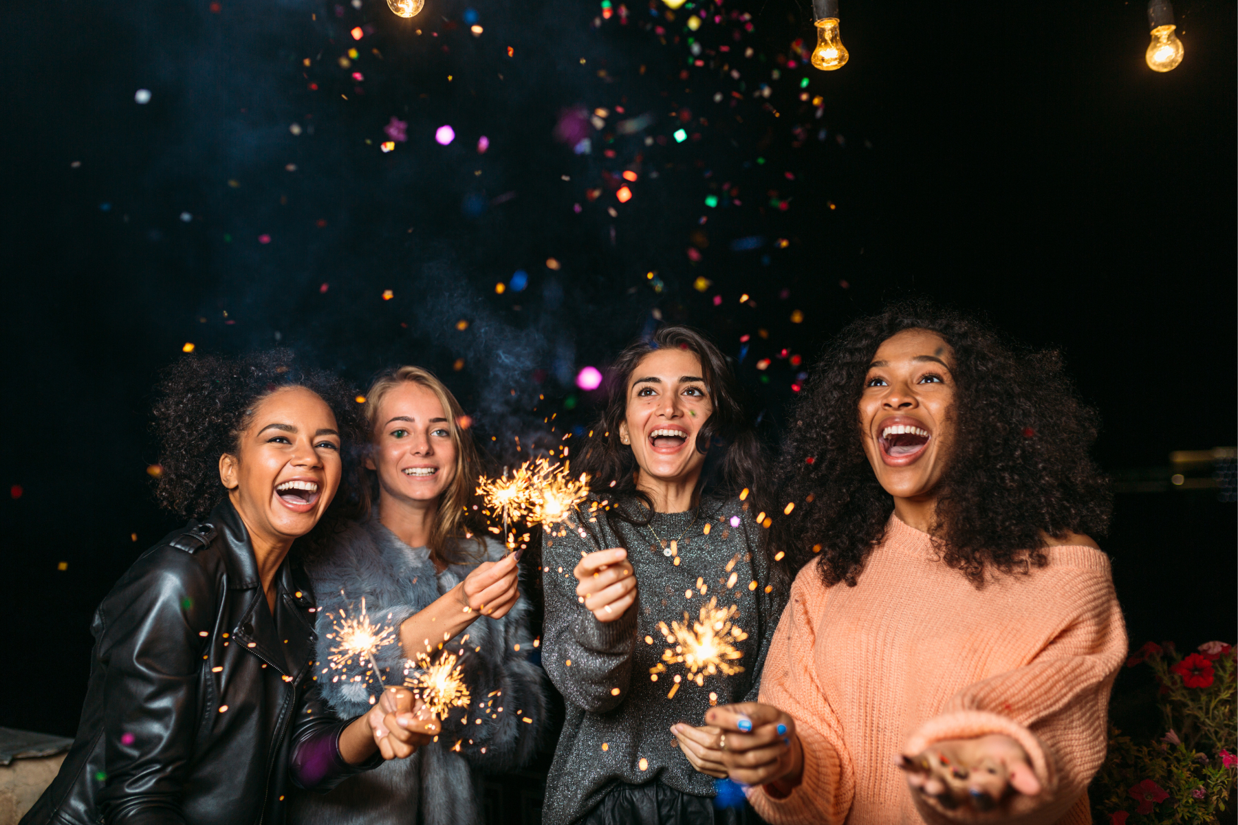 Friends holding sparklers
